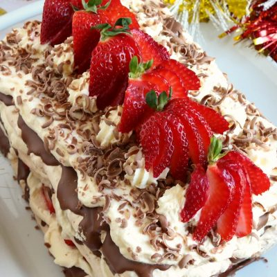 strawberries & cream hazelnut meringue cake